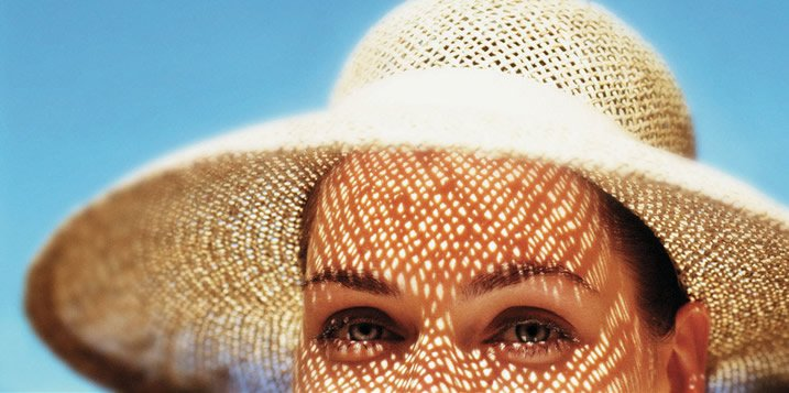 Lady with sun hat blue sky